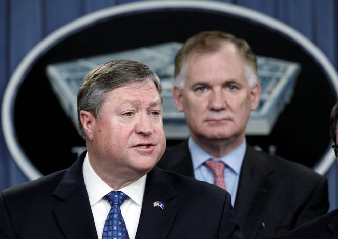Secretary of the Air Force Michael Donley (left) and Deputy Defense Secretary William Lynn announce the KC-46A tanker contract award to Boeing Co. during a news conference at the Pentagon in Washington on Thursday. (Associated Press)