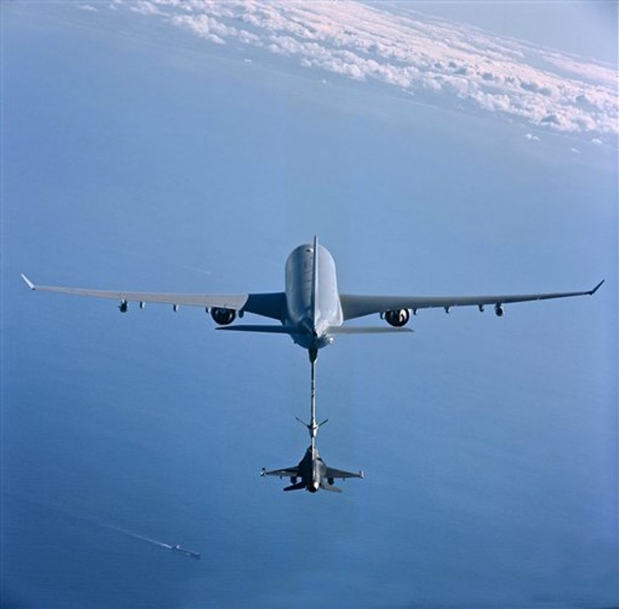 This undated photo provided by European Aeronautic Defense and Space Company (EADS) shows an aerial refueling tanker aircraft, that EADS North America has offered to the U.S. Air Force as the KC-45, as it refuels an F-16 fighter aircraft via a refueling boom system. EADS is competing with Boeing Co. to win a $35 billion contract to build nearly 200 giant airborne refueling tankers, to replace the Air Force's Eisenhower-era KC-135 planes. If EADS wins, the tanker would be assembled in Mobile, Ala., at the former Brookley military base, shuttered in the 1960s. Either way, about 50,000 jobs would be created in the U.S. (AP Photo/EADS North America)  NO SALES.