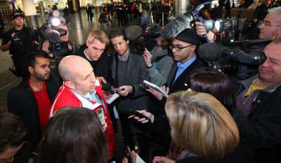 Ewan Black talks to reporters at London's Gatwick Airport on Thursday, Feb. 24, 2011, after arriving on a chartered evacuation flight from Tripoli, Libya. (AP Photo/Gareth Fuller/PA)