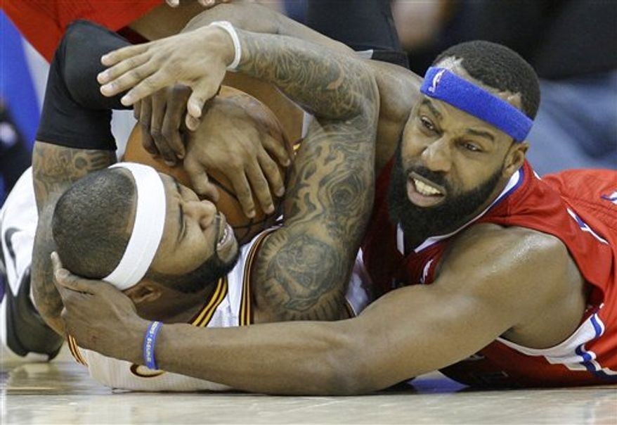 FILE - This is a Feb. 11, 2011 file photo of Cleveland Cavaliers' Mo Williams, left, battling Los Angeles Clippers' Baron Davis, right, for a loose ball in an NBA basketball game in Cleveland. Davis, one of the league's top point guards, is on the verge of being traded to the Cleveland Cavaliers for Mo Williams and forward Jamario Moon. A person familiar with the trade told The Associated Press, Thursday, Feb. 24, 2011, the deal is close to being finalized.  (AP Photo/Tony Dejak, File)