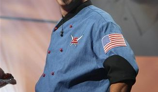 FILE-  This file image released by Food Network shows chef Michael Symon. Symon won for top burger at the South Beach Wine and Food Festival Burger Bash Thursday, Feb. 24, 2011, in Miami Beach, Fla.   (AP Photo/Food Network, FILE)  NO SALES