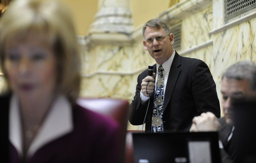 Maryland State Sen. Allan Kittleman, Howard County Republican, speaks Thursday on the state Senate floor in Annapolis, Md., in support of the gay marriage bill as State Sen. Nancy Jacobs, Harford County Republican, sits at left. (Associated Press)