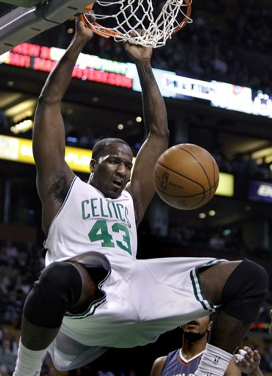 FILE-This March 3, 2010 file photo shows Boston Celtics center Kendrick Perkins dunking  against the Charlotte Bobcats during the first half of an NBA basketball game in Boston. Perkins was traded to Oklahoma City Thursday Feb. 24, 2011 for Jeff Green and Nenad Krstic. (AP Photo/Elise Amendola,File)
