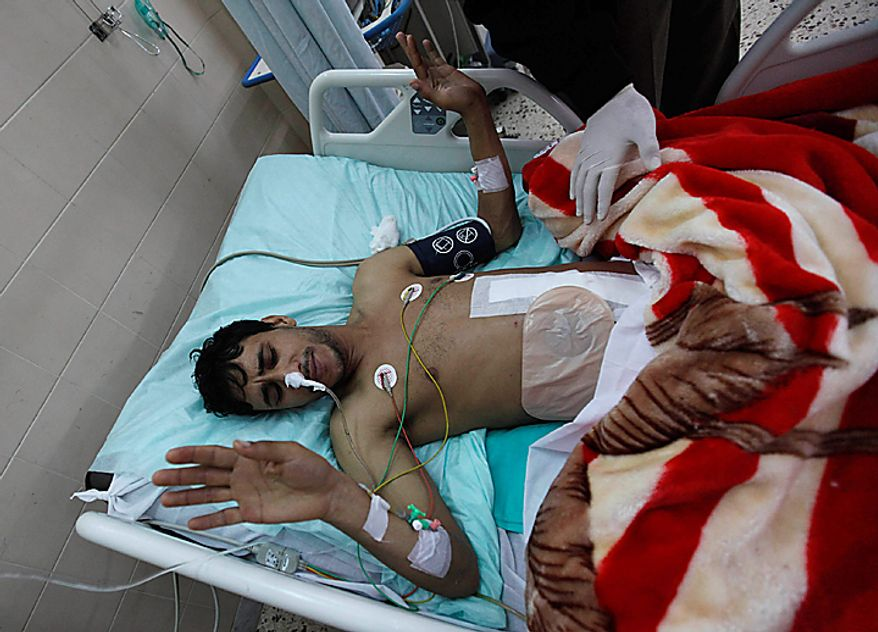 A Libyan man who was injured during a demonstration last week against Libyan leader Moammar Gadhafi lies on a bed at a hospital, in Benghazi, Libya, on Thursday Feb. 24, 2011. (AP Photo/Hussein Malla)