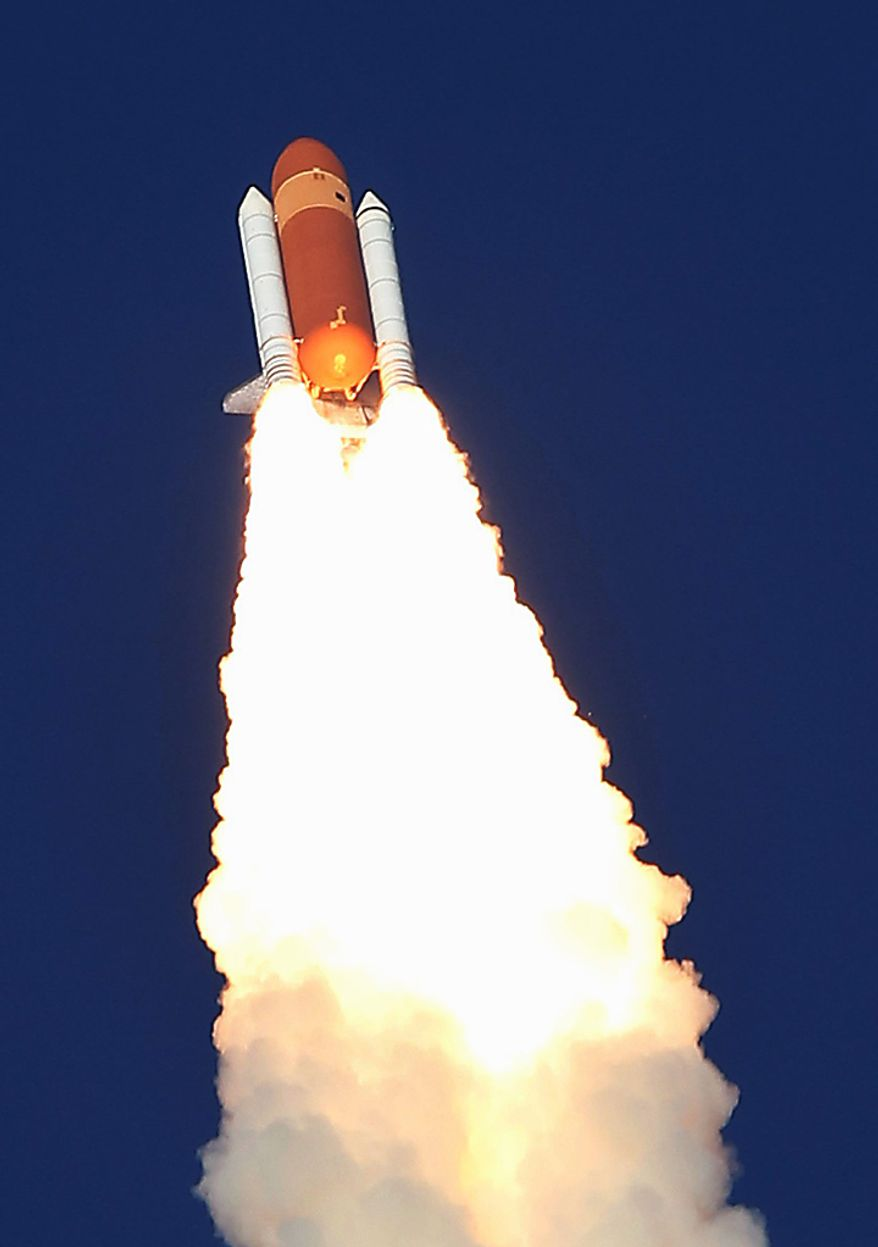 Space shuttle Discovery lifts off from Pad 39A at the Kennedy Space Center in Cape Canaveral, Fla., Thursday, Feb. 24, 2011. Discovery, on its last mission, will carry a crew of six astronauts to the Leonardo Permanent Multipurpose Module, or PMM, to the International Space Station. (AP Photo/Wilfredo Lee)