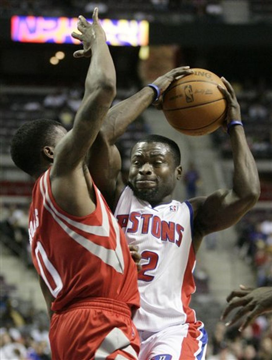 Detroit Pistons' Will Bynum, right, is pressured by Houston Rockets' Aaron Brooks in the second half of an NBA basketball game Tuesday, Feb. 22, 2011, in Auburn Hills, Mich. Brynum scored 21 points, but the Rockets won 108-100. (AP Photo/Duane Burleson)