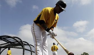 Pittsburgh Pirates manager Clint Hurdle watches his team as the pitchers take part in a bunting contest during spring training baseball practice, Thursday, Feb. 24, 2011, in Bradenton, Fla. (AP Photo/Eric Gay)
