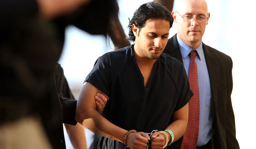 ** FILE ** Khalid Ali-M Aldawsari is escorted to his initial court appearance at the Mahon Federal Building in Lubbock, Texas, on Friday, Feb. 25, 2011. Mr. Aldawsari, a college student from Saudi Arabia, is accused of buying chemicals online as part of a plan to blow up key U.S. targets, including the home of former President George W. Bush. (AP Photo/Lubbock Avalanche-Journal, Zach Long)