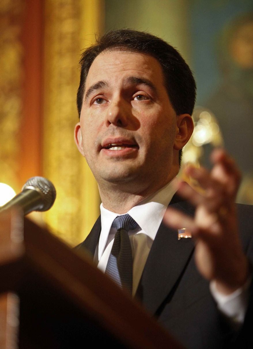 Wisconsin Gov. Scott Walker addresses the media at the state Capitol in Madison, Wis., on Thursday, Feb. 24, 2011. (AP Photo/Andy Manis)