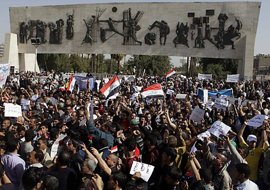 """Protesters chant anti-Iraqi government slogans during a protest at Tahrir Square in Baghdad Friday, Feb. 25, 2011.  Hundreds of demonstrators converged on central Baghdad as part of an anti-government rally inspired by uprisings across the Middle East and dubbed the """"Day of Rage.""""AP Photo/Karim Kadim)"""
