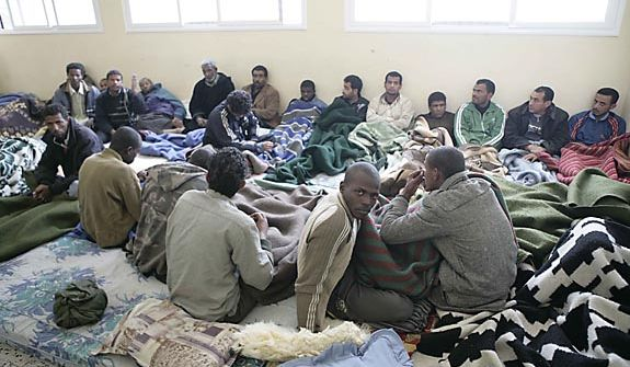 In this photo released by China's Xinhua News Agency, suspected mercenaries sit in a room in a school as they are held by anti-government protesters in the east Libyan city of Albayda, Thursday, Feb. 24, 2011. (AP Photo/Xinhua, Nasser Nouri)