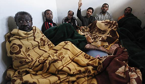 Suspected African mercenaries sit in a cell at the court in Benghazi, Libya, Friday Feb. 25, 2011. Anti-Gadhafi forces said they had captured the men in their successful fight for control of Benghazi, the country's second-largest city, where mercenaries are being blamed for killing scores of protesters. (AP Photo/Hussein Malla)
