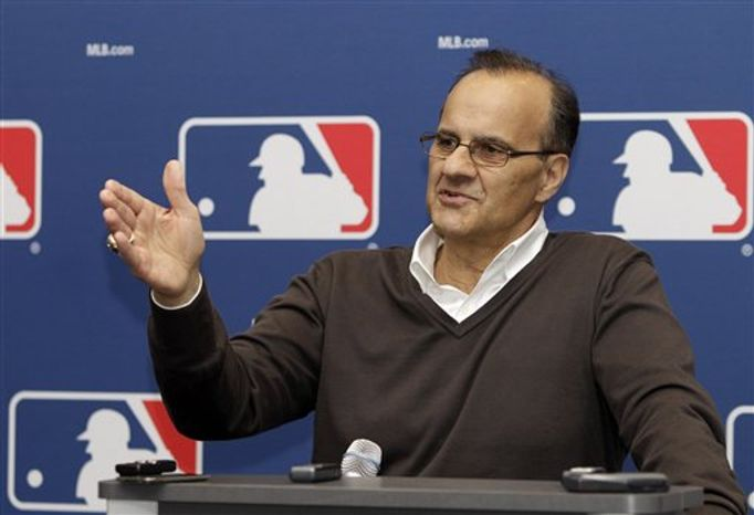 ** FILE ** Joe Torre looks on during a news conference to announce his new position as Major League Baseball's Executive Vice President of Baseball Operations, in Scottsdale,  Ariz. Saturday, Feb. 26, 2011. (AP Photo/Marcio Jose Sanchez)