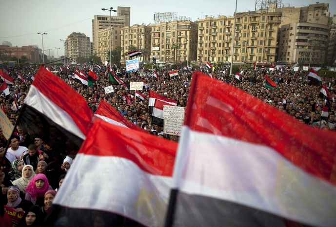 Egyptian protesters gather to demand Libyan leader Moammar Gadhafi step down during demonstrations in Tahrir Square in Cairo Friday, Feb. 25, 2011.  (AP Photo/Kevin Frayer)