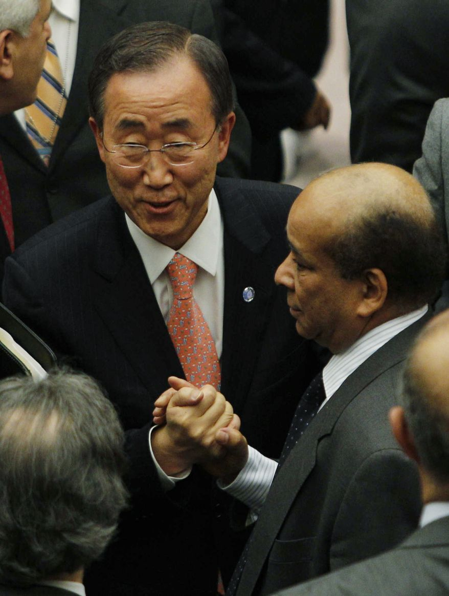 U.N. Secretary-General Ban Ki-moon greets Libya's U.N. ambassador, Mohamed Shalgham, after a meeting of the Security Council at the United Nations in New York on Friday, Feb. 25, 2011. (AP Photo/Frank Franklin II)