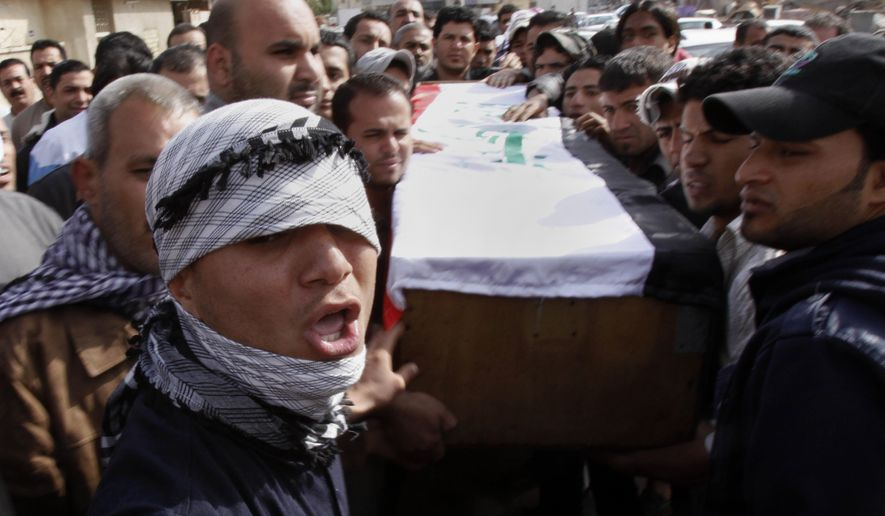 Relatives of Salim Farooq, 18, carry his coffin during his funeral procession in Basra, Iraq, the country's second-largest city, on Saturday, Feb. 26, 2011. Farooq was killed on Friday during a demonstration in Basra, his family said. (AP Photo/Nabil al-Jurani)