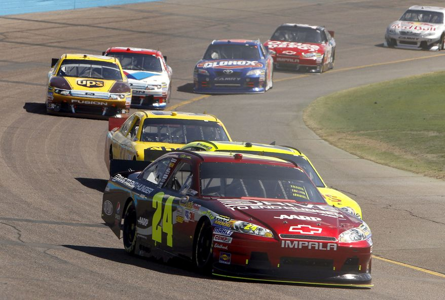 Jeff Gordon (24) drives into the fourth turn during the NASCAR Sprint Cup Series auto race at Phoenix International Raceway on Sunday, Feb. 27, 2011, in Avondale, Ariz. (AP Photo/Ross D. Franklin)