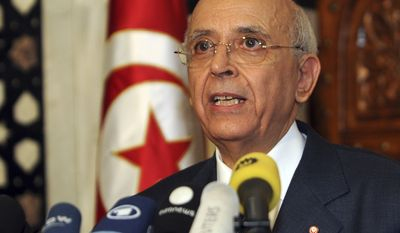 ** FILE ** Tunisian Prime Minister Mohamed Ghannouchi announces a national unity government in Tunis, Tunisia, on Monday, Jan. 17, 2011. (AP Photo/Hassene Dridi, File)