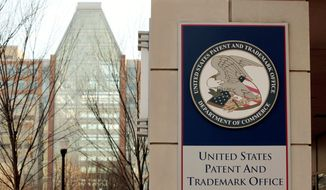 The U.S. Patent and Trademark Office building in Alexandria, Va., has a contemporary look, but Senators trying to update the patent system say it's stuck in the 1950s and needs to catch up with 21st-century technology. A bipartisan bill to reform the system is headed for Senate debate. (Associated Press)