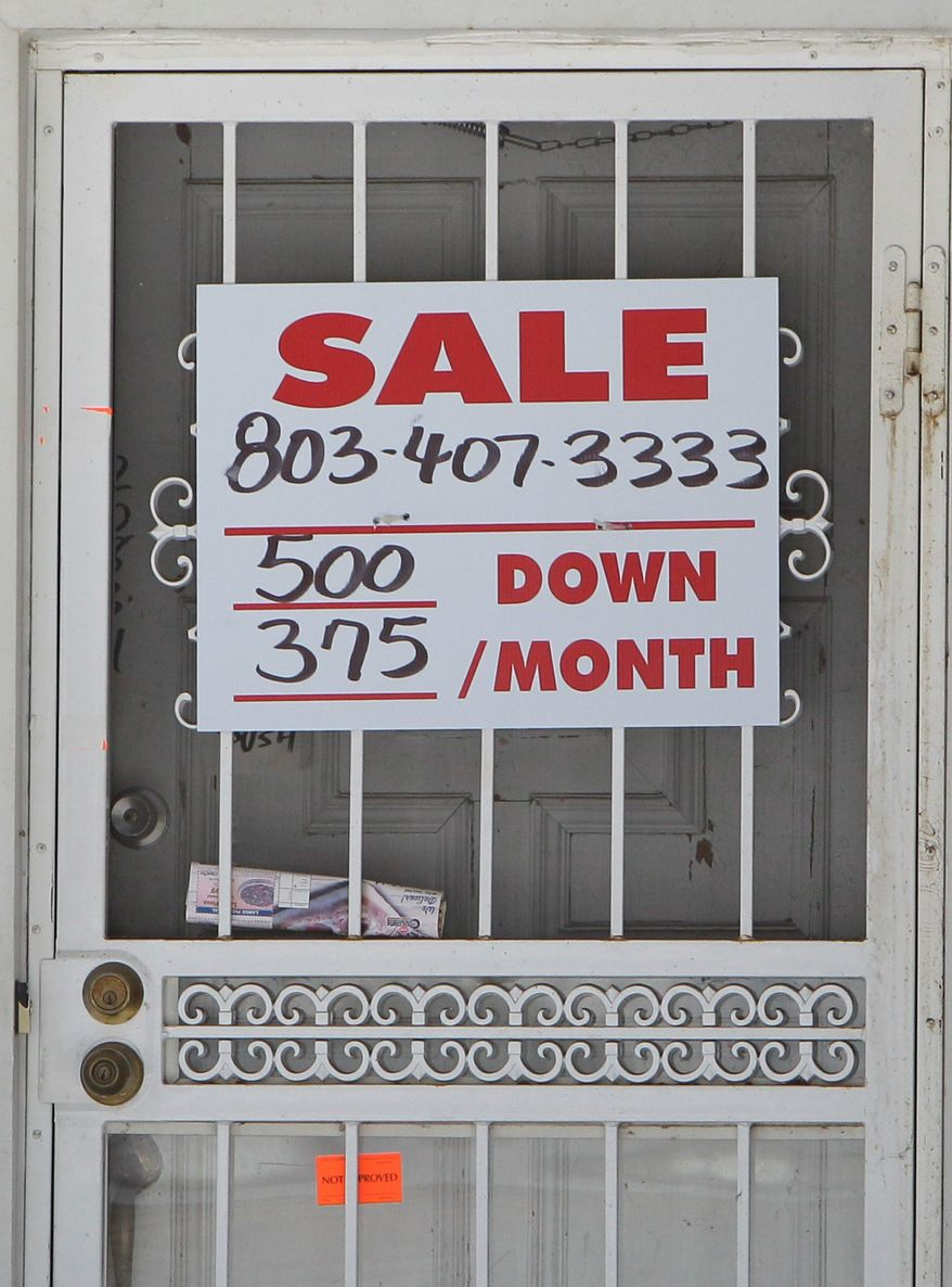 A sign in the Detroit suburb of Southfield, Mich., shows the depressed state of local housing, which has attracted low-income buyers and renters from the inner city into the middle-class enclave. (Associated Press)