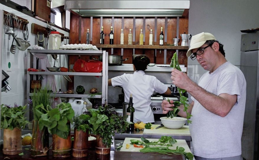 Cuban chef Inti Langaney prepares vegetarian food at the eco-restaurant El Romero in Pinar del Rio, Cuba, last month. Located in the Las Terrazas natural reserve about 50 miles east of Havana, El Romero goes beyond garden-variety vegetables, spinning forgotten and little-known plants into delectable dishes. (Associated Press)