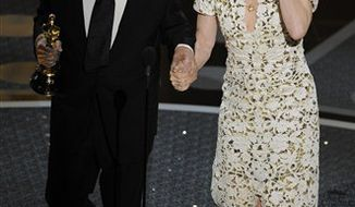 "Kirk Douglas escorts Melissa Leo  after she accepted the Oscar for best actress in a supporting role for ""The Fighter"" at the 83rd Academy Awards on Sunday, Feb. 27, 2011, in the Hollywood section of Los Angeles. (AP Photo/Mark J. Terrill)"