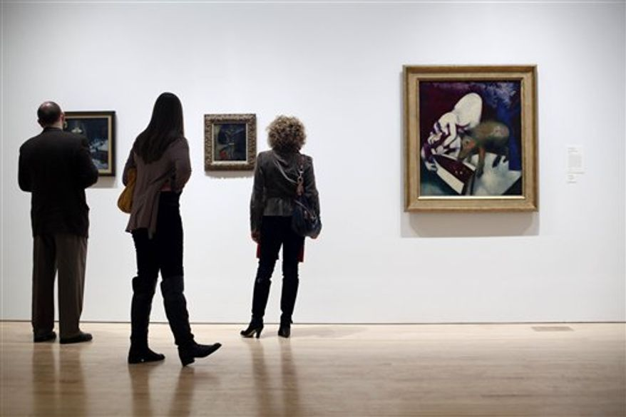 "In this Friday, Feb. 25, 2011 photo, people attend the exhibit, ""Paris Through the Window: Marc Chagall and His Circle,"" during a media preview at the Philadelphia Museum of Art in Philadelphia. The exhibit is scheduled to run from March 1 to  July 10.  (AP Photo/Matt Rourke)"