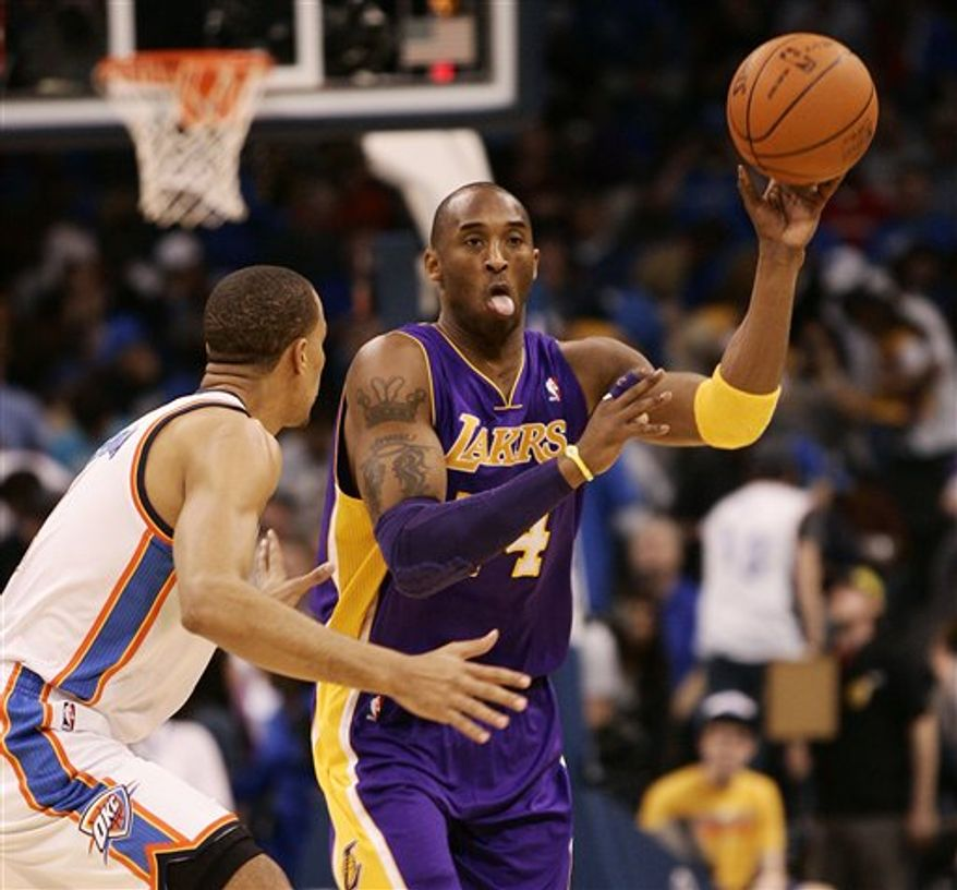 Oklahoma City Thunder forward Kevin Durant, right, and Los Angeles Lakers forward Ron Artest, left, tussle for the ball during the first half of an NBA basketball game Sunday, Feb. 27, 2011, in Oklahoma City. (AP Photo/James Schammerhorn)