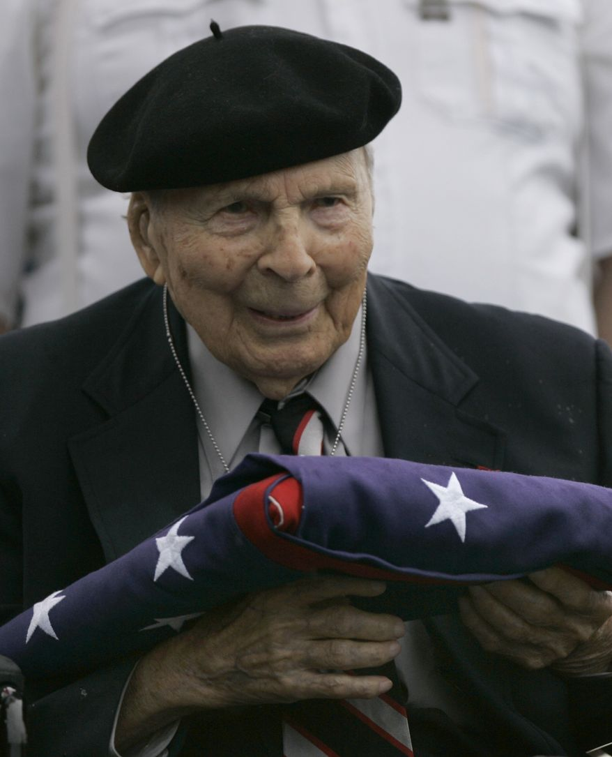 ** FILE ** Frank Buckles receives an American flag during Memorial Day activities at the National World War I Museum in Kansas City, Mo., in 2008. Mr. Buckles, the last U.S. doughboy from the Great War, died on Sunday, Feb. 27, 2011, of natural causes at his home in Charles Town, W.Va. (Associated Press)