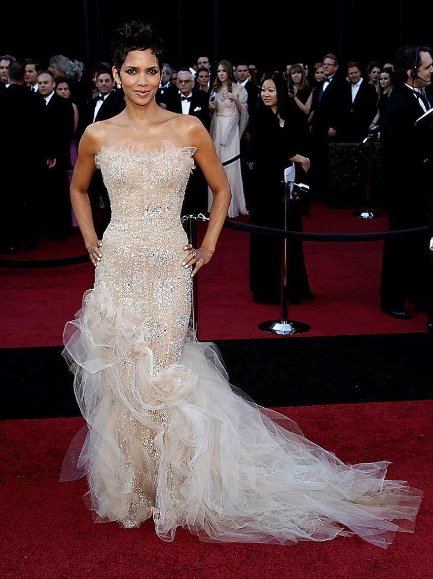 Actress Halle Berry arrives before the 83rd Academy Awards on Sunday, Feb. 27, 2011, in the Hollywood section of Los Angeles. (AP Photo/Matt Sayles)
