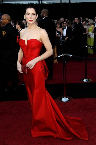 Actress Sandra Bullock arrives before the 83rd Academy Awards on Sunday, Feb. 27, 2011, in the Hollywood section of Los Angeles. (AP Photo/Matt Sayles)