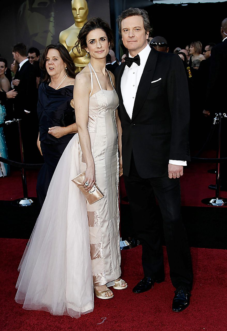 Actor Colin Firth, right, arrives with wife Livia Giuggioli before the 83rd Academy Awards on Sunday, Feb. 27, 2011, in the Hollywood section of Los Angeles. (AP Photo/Matt Sayles)