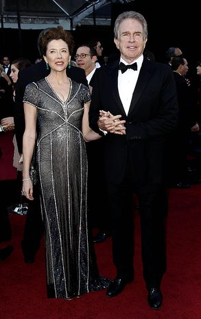 Actress Annette Bening, left, and husband Warren Beatty arrive before the 83rd Academy Awards on Sunday, Feb. 27, 2011, in the Hollywood section of Los Angeles. (AP Photo/Matt Sayles)