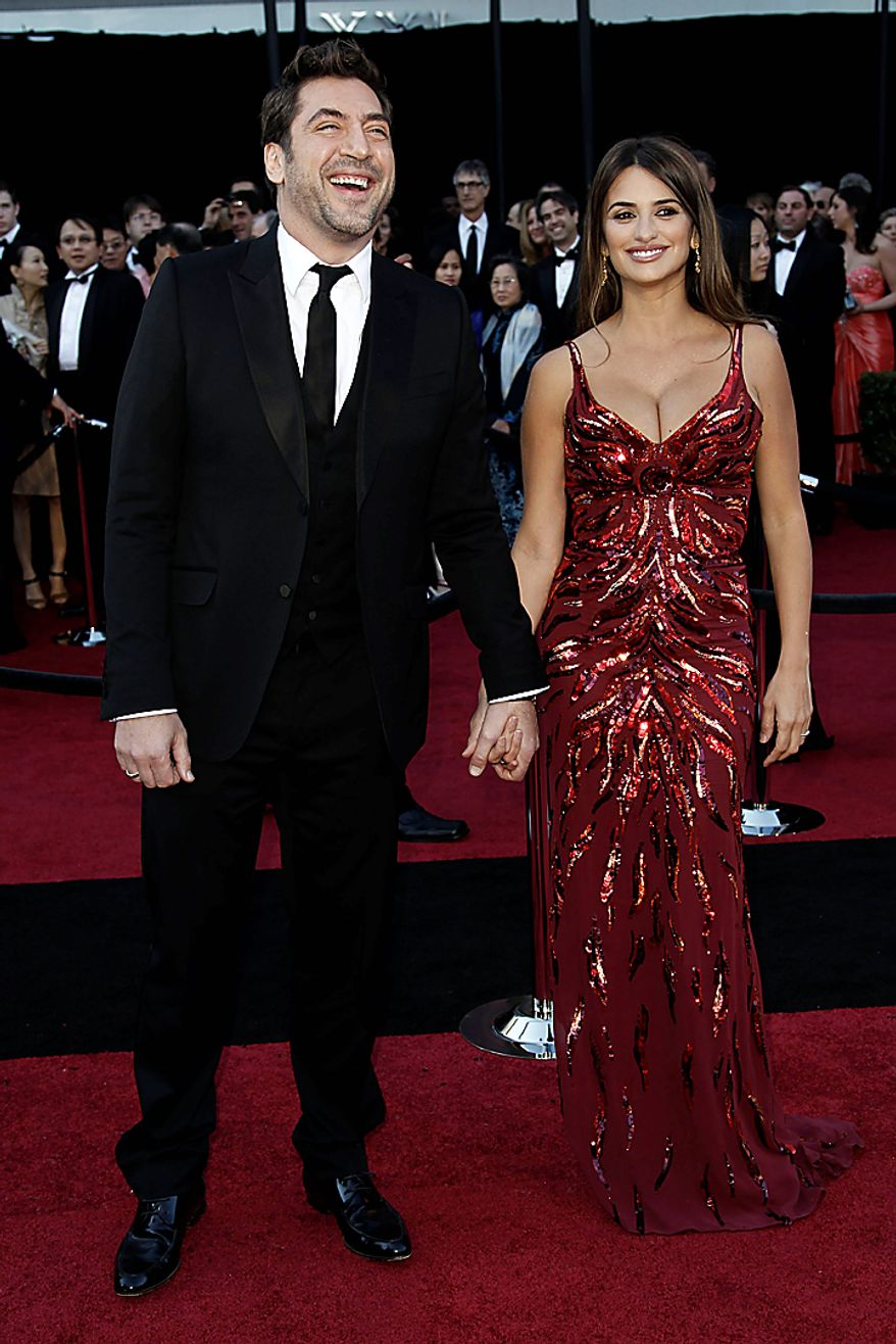 Actors Javier Bardem (left) and Penelope Cruz arrive for the 83rd Academy Awards on Sunday, Feb. 27, 2011, in the Hollywood area of Los Angeles. (AP Photo/Matt Sayles)