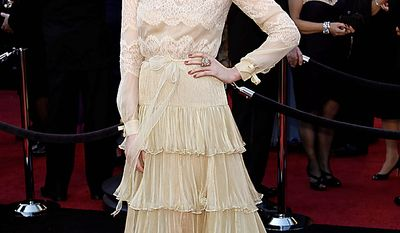 Singer Florence Welch arrives before the 83rd Academy Awards on Sunday, Feb. 27, 2011, in the Hollywood section of Los Angeles. (AP Photo/Matt Sayles)