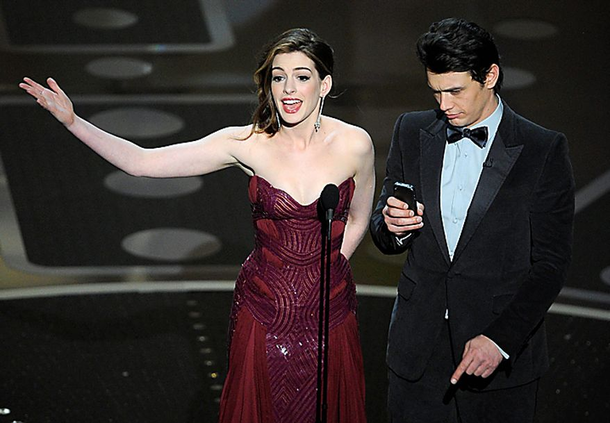 Show hosts Anne Hathaway, left, and James Franco are seen during the 83rd Academy Awards on Sunday, Feb. 27, 2011, in the Hollywood section of Los Angeles. (AP Photo/Mark J. Terrill)