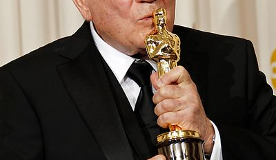 """David Seidler poses backstage with the Oscar for best original screenplay for """"The King's Speech"""" at the 83rd Academy Awards on Sunday, Feb. 27, 2011, in the Hollywood section of Los Angeles. (AP Photo/Matt Sayles)"""