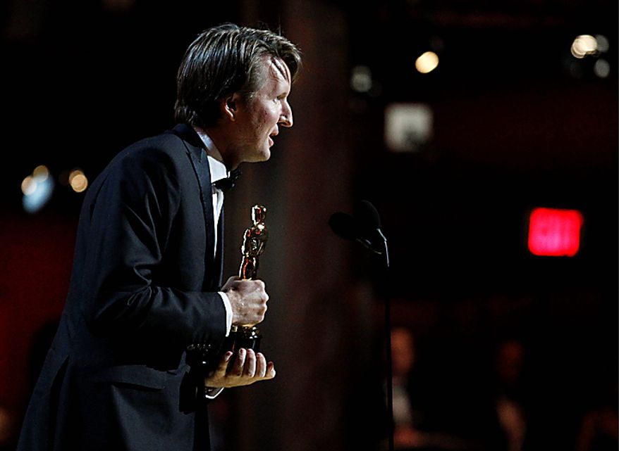 """Tom Hooper accepts the Oscar for best achievement in directing for """"The King's Speech"""" at the 83rd Academy Awards on Sunday, Feb. 27, 2011, in the Hollywood section of Los Angeles. (AP Photo/Chris Carlson)"""