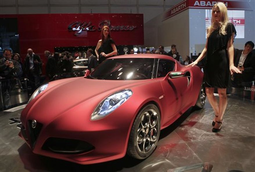 The new Ferrari FF is presented by Ferarri's chairman Luca Cordero di Montezemolo during the press day of the 81st International Motor show in Geneva, Switzerland, Tuesday, March 1,  2011. The International Motor show will run from March 3rd to 13th. (AP Photo/Anja Niedringhaus)