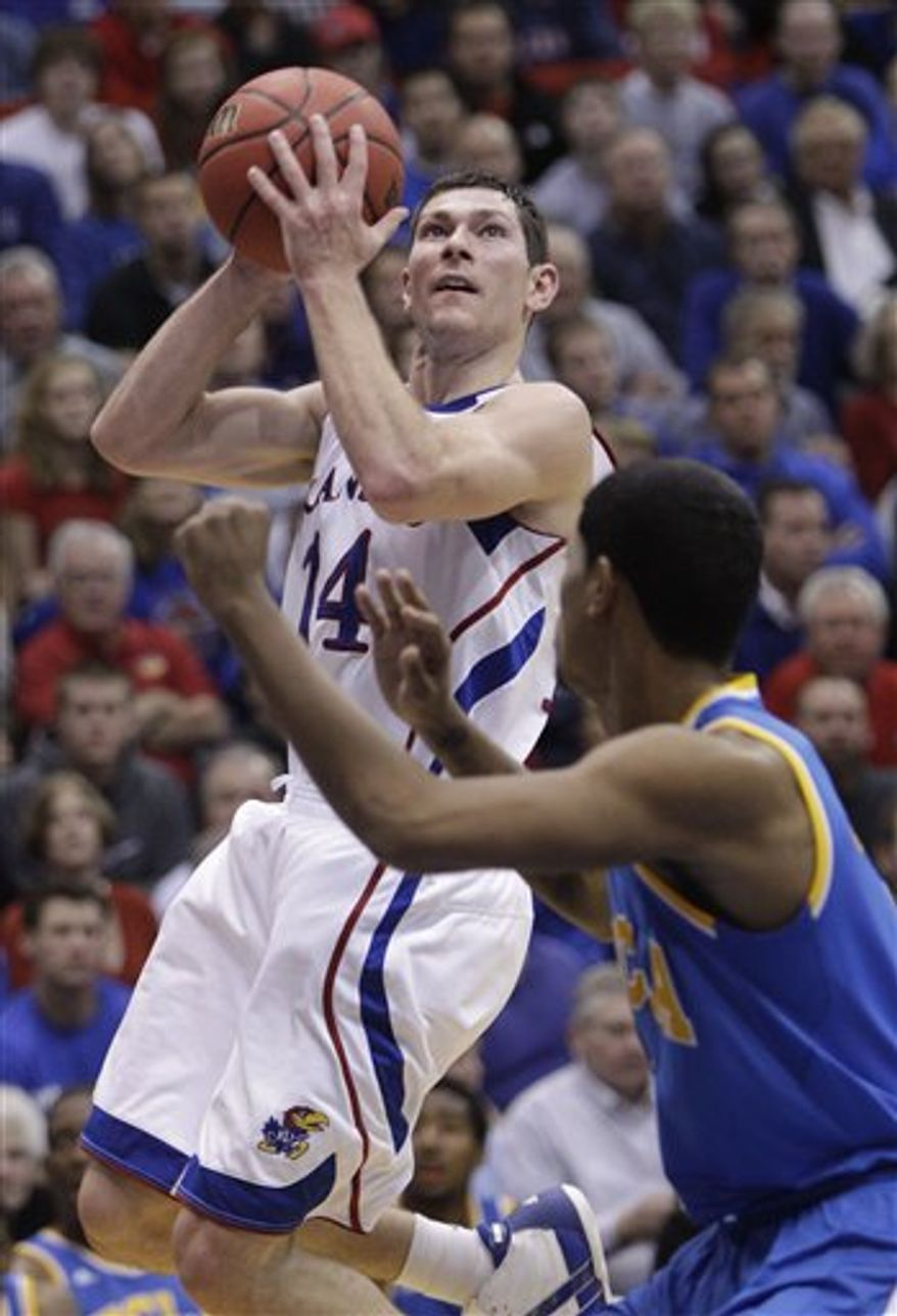 FILE - In this Dec. 2, 2010 file photo, Kansas guard Tyrel Reed (14) shoots over UCLA guard Tyler Lamb (1) during the first half of an NCAA college basketball game in Lawrence, Kan. Reed's favorite memory of four years as a Kansas basketball player was probably winning the national championship. But there are so many special moments that come flooding back as the native Kansan prepares to run onto the Allen Fieldhouse floor for the very last time.  (AP Photo/Orlin Wagner, File)