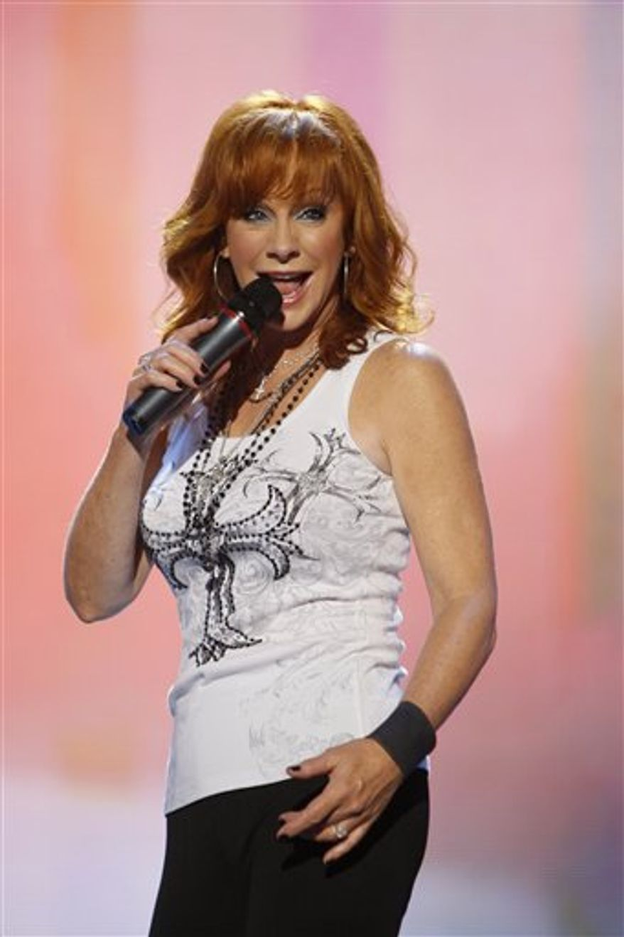 FILE - In this June 11, 2010 file photo, Reba McEntire performs during the CMA Music Festival in Nashville, Tenn. (AP Photo/Wade Payne, file)
