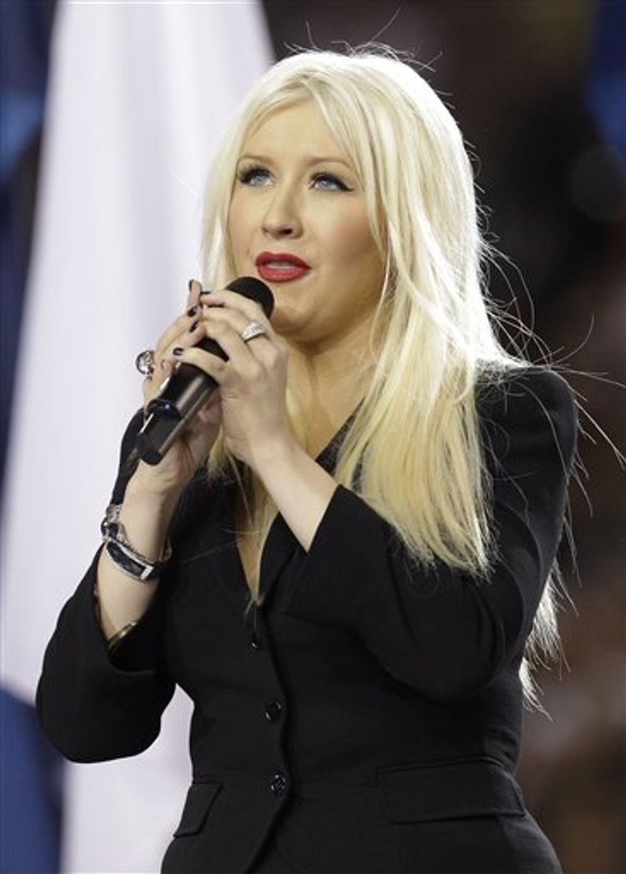 FILE - In this Feb. 6, 2011 file photo, Christina Aguilera sings the national anthem before the NFL football Super Bowl XLV game between the Green Bay Packers and the Pittsburgh Steelers in Arlington, Texas. Aguilera has been released from jail after being arrested for being drunk in public, and authorities don't plan to seek criminal charges. (AP Photo/David J. Phillip, file)