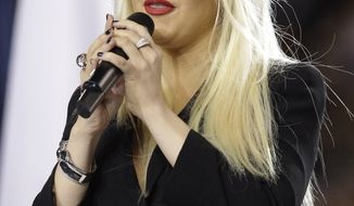 Christina Aguilera sings the national anthem before the NFL football Super Bowl XLV game between the Green Bay Packers and the Pittsburgh Steelers in Arlington, Texas, on Feb. 6, 2011. Miss Aguilera was arrested for being drunk in public late Monday, Feb. 28, 2011. (AP Photo/David J. Phillip, file)