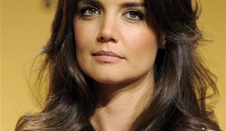 FILE - In this Jan. 16, 2011 file photo, actress Katie Holmes is pictured before announcing nominations for the 68th Annual Golden Globe Awards in Beverly Hills, Calif. (AP Photo/Chris Pizzello, file)
