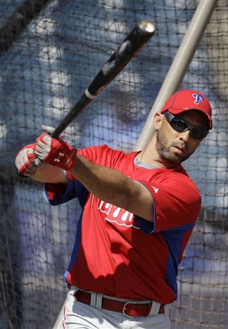 Philadelphia Phillies left fielder Raul Ibanez waits to hit in the batting cage before a baseball spring training game against the New York Yankees Saturday, Feb. 26, 2011, at Steinbrenner Field in Tampa, Fla. (AP Photo/Charlie Neibergall)