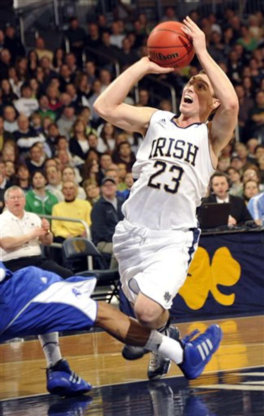 Notre Dame guard Ben Hansbrough trips as he puts up a shot during first half action in an NCAA college basketball game with Seton Hall Saturday Feb. 26, 2011 in South Bend, Ind. Notre Dame won 60-48 with Hansbrough scoring 21 points.  (AP Photo/Joe Raymond)