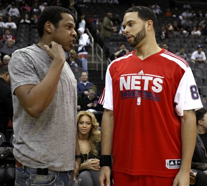 New Jersey Nets point guard Deron Williams scores a free throw during the first quarter of an NBA basketball game against the Phoenix Suns, Monday, Feb. 28, 2011, in Newark, N.J. Williams was recently traded from the Utah Jazz. (AP Photo/Julio Cortez)