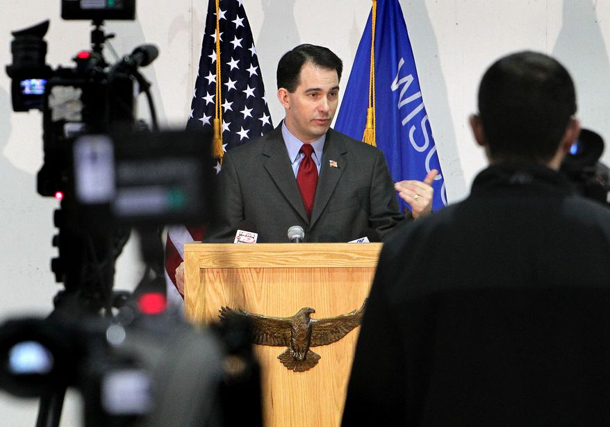 Wisconsin Gov. Scott Walker addresses the media at a news conference at Colgan Air Services at the La Crosse Municipal Airport in La Crosse, Wis., on Monday, Feb. 28, 2011. The governor called on the missing Democratic state senators to return to Madison, the state capital. (AP Photo/La Crosse Tribune, Erik Daily)