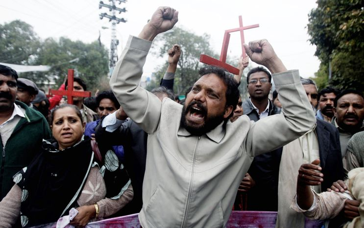 People from the Pakistani Christian community rally to condemn the death of Shahbaz Bhatti, minister for minorities affairs, during a rally in Lahore, Pakistan, on Wednesday. Gunmen fatally shot Mr. Bhatti, the latest attack on a high-profile Pakistani figure threatened by Islamist militants for urging reform of harsh blasphemy laws that impose the death penalty for insulting Islam. (Associated Press)