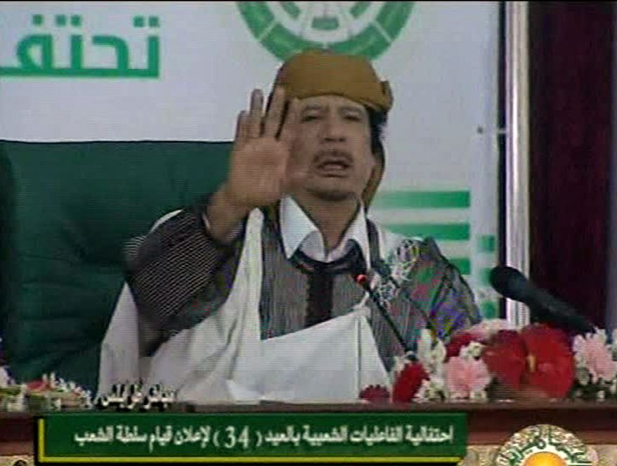 Libyan leader Moammar Gadhafi addresses supporters and journalists in capital Tripoli on Wednesday, March 2, 2011. (AP Photo/Libyan state television via APTN)